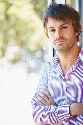 Buy stock photo Confident business man leaning against glass window