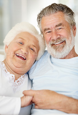 Buy stock photo Portrait of a smiling senior couple sitting at home