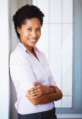 Buy stock photo African American business woman with hands folded leaning against wall
