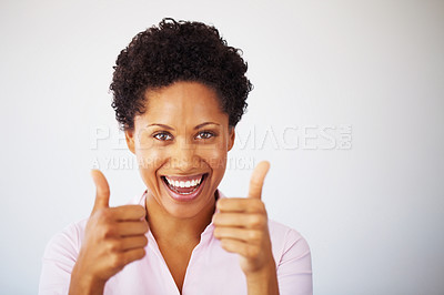 Buy stock photo Closeup of young business woman giving two thumbs up on white background