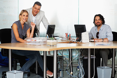 Buy stock photo Team leader with his team working in the office
