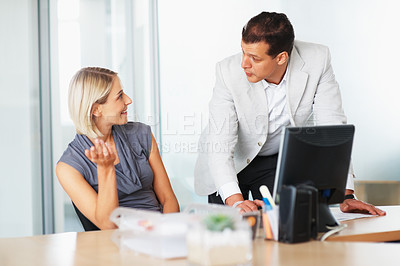 Buy stock photo Leader brainstorming with female executive at office