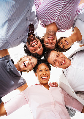 Buy stock photo Low angle view of business people with their heads together