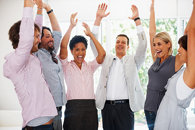 Buy stock photo Successful business people with their hands raised