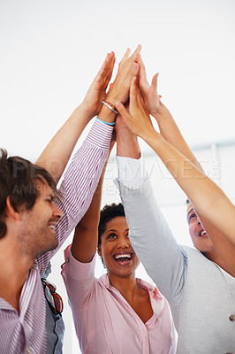 Buy stock photo Business team celebrating success with high five
