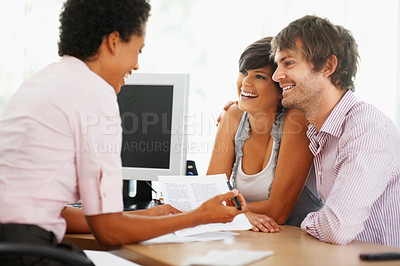 Buy stock photo Professional consultant talking with young couple at office