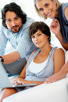 Buy stock photo Young business woman with team discussing something on laptop