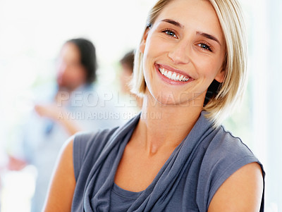 Buy stock photo Happy attractive woman with colleagues talking in background