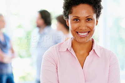 Buy stock photo Closeup of pretty woman with colleagues in background