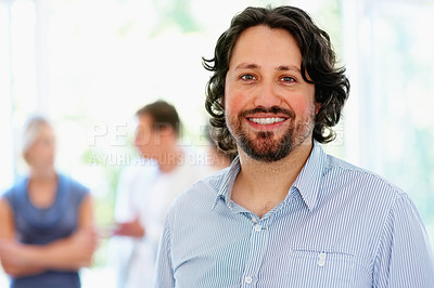 Buy stock photo Closeup of man with people in background