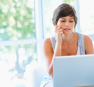 Buy stock photo View of pretty woman working on laptop
