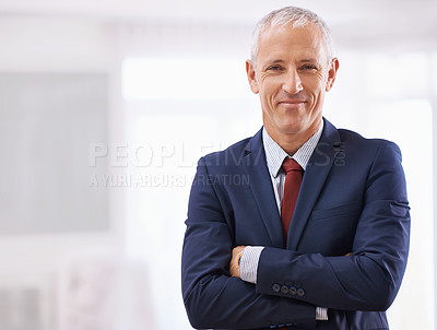 Buy stock photo Cropped shot of a mature businessman with folded arms