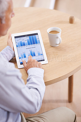 Buy stock photo Cropped shot of a businessman pointing at figures on his tablet