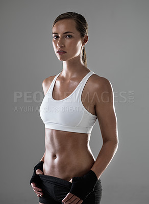 Buy stock photo Cropped shot of an athletic woman ready for her kickboxing class