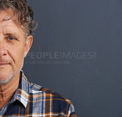 Buy stock photo A cropped portrait of a handsome mature man standing against a grey background