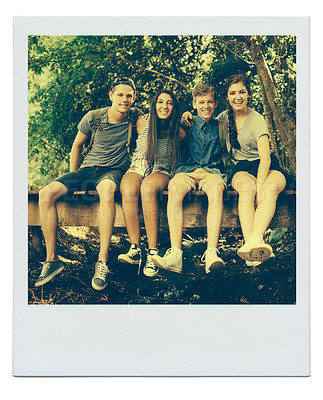 Buy stock photo Framed image of a group of teenage friends sitting together on a wooden bridge in a forest