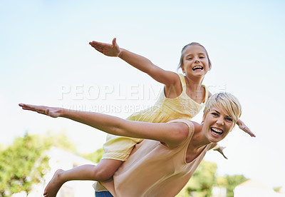Buy stock photo A portrait of a happy mother and daughter playing in the park on a sunny day