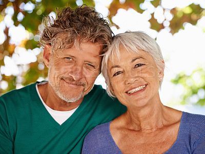 Buy stock photo Portrait of a mature couple sitting outdoors