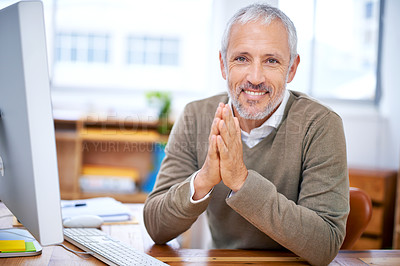 Buy stock photo A portrait of a happy businessman sitting at his desk at work
