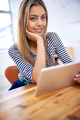 Buy stock photo A portrait of a beautiful young professional using a tablet at her desk