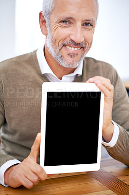Buy stock photo A cropped portrait of a happy businessman showing a tablet with a blank screen