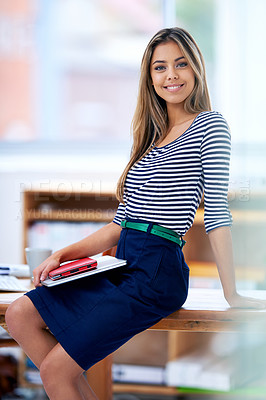 Buy stock photo A portrait of a beautiful young professional sitting on a desk in her office