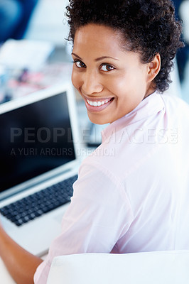 Buy stock photo Rear view of woman smiling while working on laptop