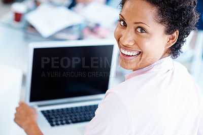 Buy stock photo Rear view of pretty woman working on her laptop
