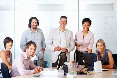 Buy stock photo Smiling businesspeople with paper work in a boardroom