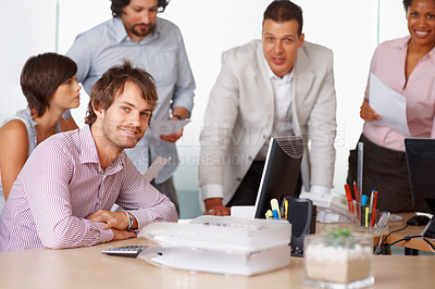 Buy stock photo Happy business man with his team discussing in board room