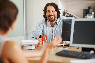 Buy stock photo Young business man discussing with his colleague in the office