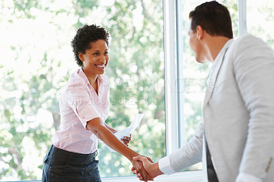 Buy stock photo Portrait of African American business woman shaking hands with man in the office