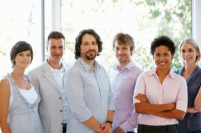 Buy stock photo Group of successful business colleagues standing together at office