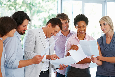 Buy stock photo Business people working with documents at briefing