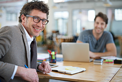 Buy stock photo Portait of  two people working together in a large office
