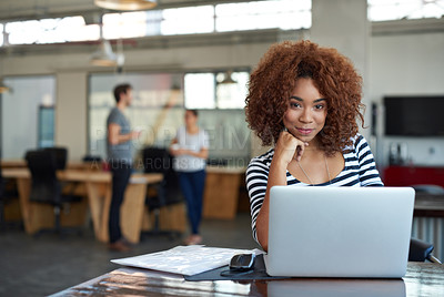 Buy stock photo Cropped shot of a young businesswoman using wireless technology in an office