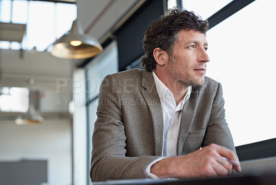 Buy stock photo Shot of a mature businessman sitting in an office