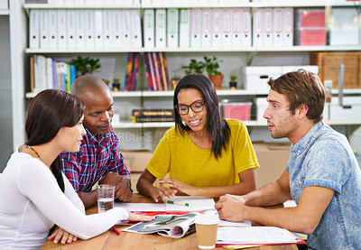 Buy stock photo Shot of a team of design professionals working together in an office