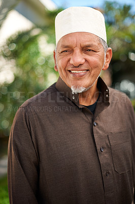 Buy stock photo Shot of a mature muslim man standing outside