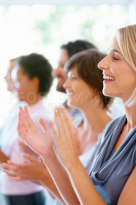 Buy stock photo Team leader with her colleagues applauding and smiling