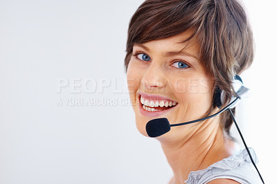 Buy stock photo Closeup of smiling call center employee wearing headset on white background