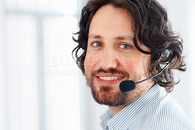 Buy stock photo Businessman using headphones and smiling at office