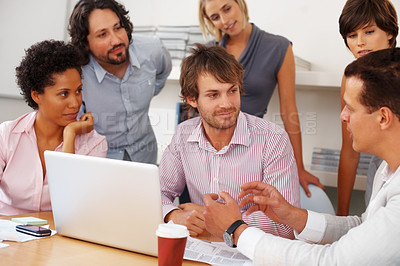 Buy stock photo Leader discussing business plan with team in the board room