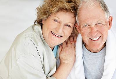 Buy stock photo Portrait of a loving senior woman embracing her husband at home