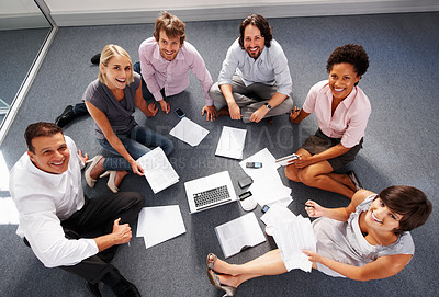 Buy stock photo Top view of business people sitting in circle and looking at you