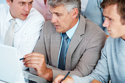 Buy stock photo Portrait of a mature businessman interacting with his associates