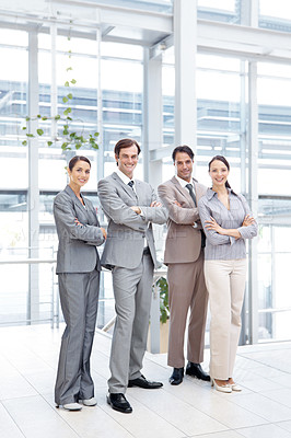 Buy stock photo Full length portrait of a positive business team smiling while standing together