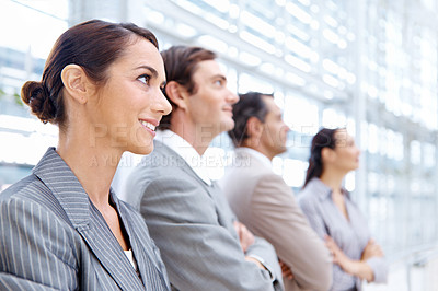 Buy stock photo Positive business team smiling while standing together - cropped