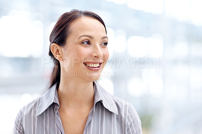 Buy stock photo Cropped view of a positive young businesswoman smiling while looking away