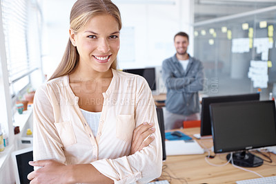 Buy stock photo Portrait of a attractive young designer with a male colleague standing in the background